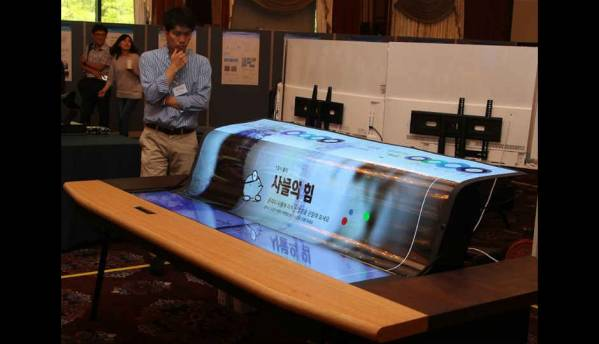 This bench is upholstered with the world's first 77-inch transparent, flexible OLED display from LG