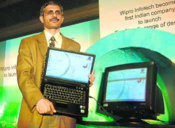 Wipro Vice-President Ashutosh Vidya displaying Wipro's eco-friendly products in Bangalore