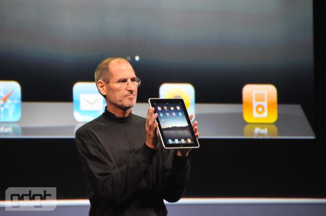 Steve Jobs displays the Apple iPad
