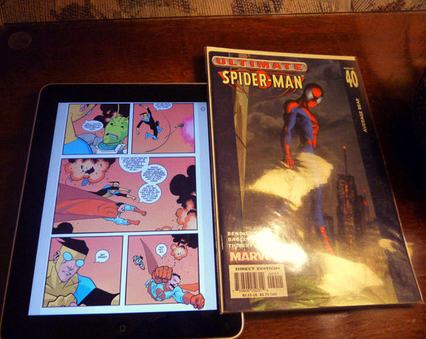 The Apple iPad displaying a comic next to a comic book