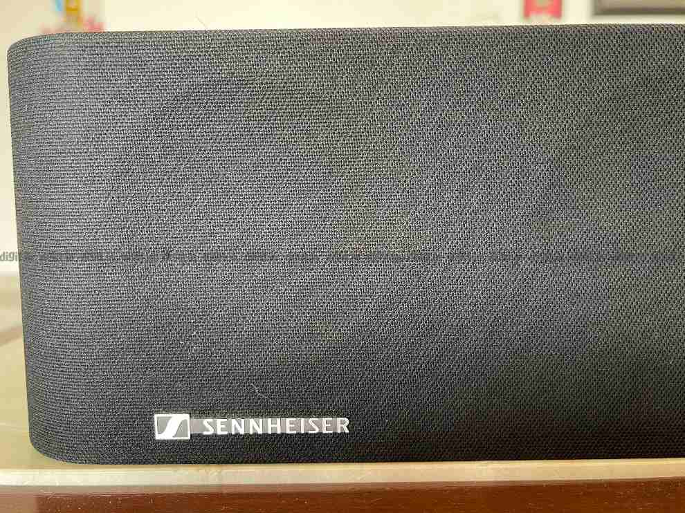 The Sennheiser logo is in the bottom left of the Ambeo soundbar.