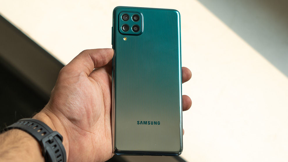 The Samsung Galaxy F62 features a laser-etched design, with straight lines and a dual-tone finish