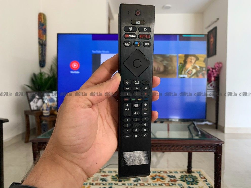 The Philips TV has a traditional remote control.